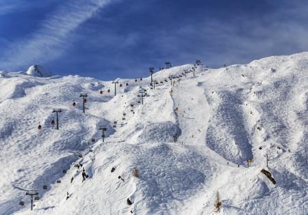 Landschaftsfotografie: Skifahrer auf dem Gletscher Kitzsteinhorn in Österreich